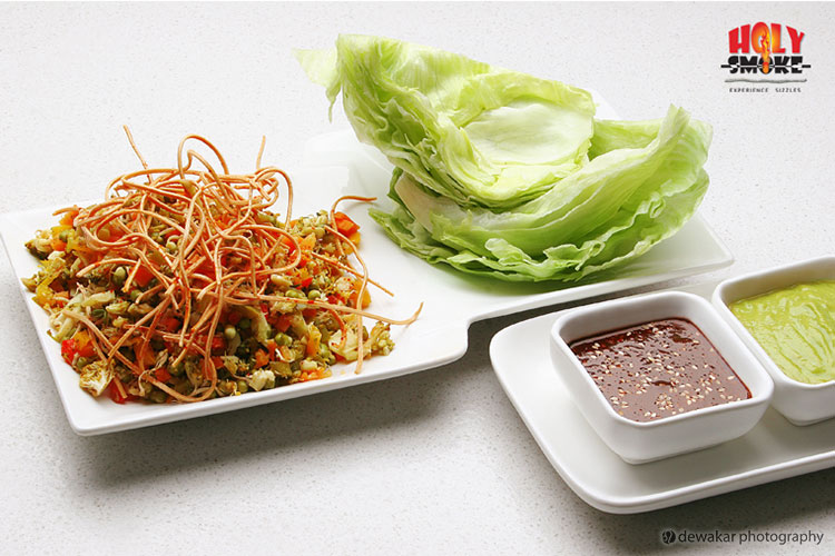 Spicy mixed vegetables topped with crispy noodles and spicy garlic and